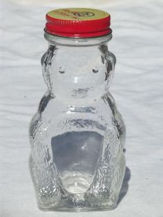 old glass honey bear jar, figural bottle savings bank / candy container