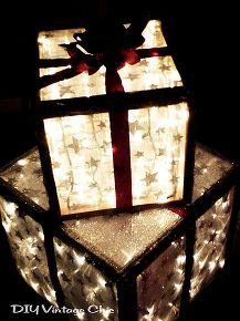 Outdoor Lighted Christmas Presents DIY these trendy holiday decorations with some wood, outdoor lights, and ribbon. Once you create the boxes in your desired dimensions, stuff some Christmas lights inside and wrap the exterior. Christmas Porch, Noel Christmas, Outdoor Christmas Decorations, Rustic Christmas, Winter Christmas, All Things Christmas, Christmas Lights, Yard Decorations, Christmas Boxes Decoration