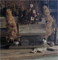 PRIMITIVE CHRISTMAS LOG CABIN #2. Old wood and real chinking on all 4 sides. Hand made brown Christmas trees. Cute to add your old Putz sheep or toy farm animals. Animals not included. Base measures 12 3/4 by 6. Cabin is 7 3/4 T. Tree stands 12 T on tallest. Fun Christmas display item!! $145 plus shipping.  💓