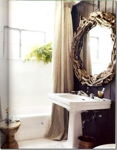"SHELTER: Gnarly- Chase Booth's bathroom, originally seen in Domino. DIY renovation with dark brown paint, fern (thrives in steam), rustic mirror and teak stool, classic sink, linen curtain, Edison industrial bulb, and Subway and penny tile--""clean, neutral and timeless."" Major inspiration! I love this mirror."