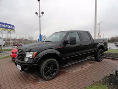 black 2012 Ford F-150 truck