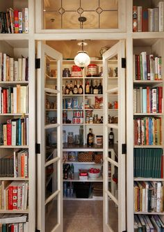 Shelves for cookbooks outside pantry.