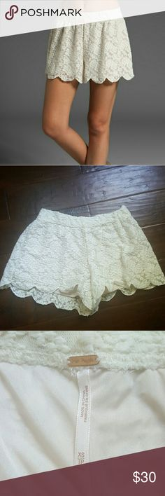 "Free People Scalloped lace short These high-waisted lace shorts feature a covered elastic waistband and a scalloped bottom hem. Lined.  * 11"" rise. 2"" inseam. * Fabrication: Lace. * Shell: 60% nylon/35% polyester/5% spandex. * Lining: 100% polyester. Free People Shorts"