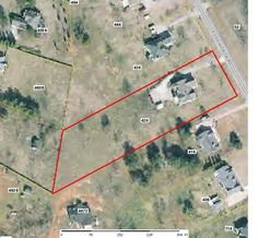 Platt from county tax assessors website: long lower side 546 ft, road frontage 143 ft, top long side 445 ft, back 166 ft. for a total of 1304 ft property line and a total area of 1.464 acres.