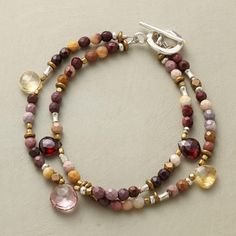 """ROUND TRIP BRACELET -- Two strands of jasper, accented with brass and sterling beads and drops of garnet, citrine and pink topaz, arrive at a sterling silver toggle. USA. Exclusive. 7-1/2""""L."""