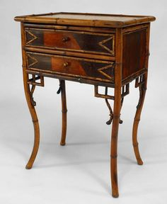 English Victorian faux bamboo 2 drawer bedside commode with inlaid panels and rust marble top.