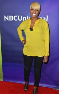 Yellow is a great color for Nene, in her yellow blouse, black skinny jeans, and black pumps.