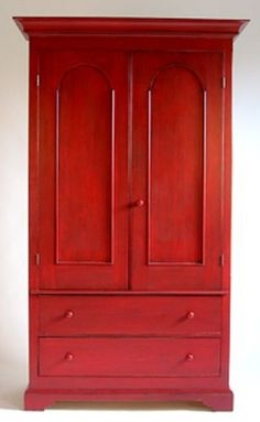 Red armoire made in Newfoundland.  Beautiful for a child's bedroom.: