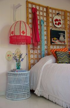 love the headboard... great for a rental space because it will not scratch the wall and hanging decor in it will = no holes!