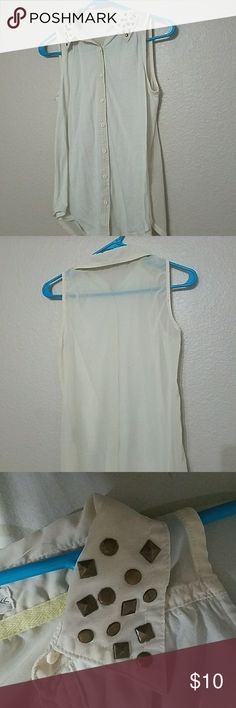 Blouse Cream colored button-down sleeveless blouse. Sheer back. Great condition. Super cute when tucked in and worn with jeans:) Tops