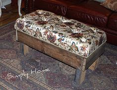 DIY Ottoman made from a pallet.  (I would use much different fabric and I would try to create a hidden storage area).