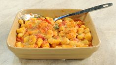 """Tender pillows of baked gnocchi mingle with two kinds of cheese in this recipe from """"Lidia's Italy in America,"""" by Lidia Bastianich. Also try her boiled variation, Gnocchi with Marinara Sauce."""