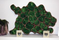 I present a handmade relief made of reindeer moss, which can become a modern decoration of your home already in the coming Easter. Moss looks lush and springy. Leading colors are copper and green.  Image dimensions: 70x50 cm depth 6.5 cm. (At the widest place)  Price: 93 € + shipping  It is possible to make a similar image of any size.  Contact: biuro@greenalleys.com.pl