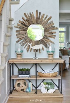 Time to accessorize your entryway and show off your personality! Avoid the desire to clutter the area with all your favorite nick-knacks. When decorating an entryway, less is more. Choose a small collection of accessories that work well with eachother. Limit your accessory colors to only 2-3 colors and 2 neutrals. Mix textures like glass, wood, natural woven materials, cloth, and ceramics or glass. Limiting colors and multiplying textures is what creates an overall cohesive design.