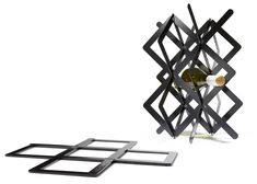 """""""The wine rack comes flat and opens up to its volumetric state the same way that the large installation does,"""" Benshetrit explains. """"It is about the idea of expansion and experiencing a very interesting 360-degree view that changes and shifts."""" Present wine rack by Dror Benshetrit for Brancott Estate"""