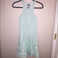 Flirty dress This cute and flirty dress is from express. Zips up in the front. Nice material. Size 0 Express Dresses