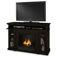 @Overstock - Create a warming glow anywhere in your home with this vent-less fireplace. The elegant fireplace uses real-flame gel fuel for a very real, beautiful fire. The dark-walnut finish adds extra style to this fireplace that doubles as an entertainment center.http://www.overstock.com/Home-Garden/The-Lannon-Ventless-Real-Flame-Gel-Fireplace/6385580/product.html?CID=214117 $608.99