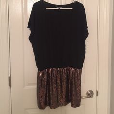Black Express Dress with gold sequin bottom! Only worn once for New Years! Top of the dress is a sheer material and fits loose while the bottom of the dress fits tight! Would look cute with boots! Express Dresses