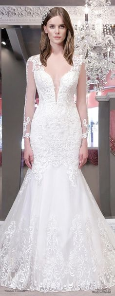 European lace drop waist with deep plunge neck line and soft illusion long sleeves with open back. Full open illusion skirt with continuous lace pattern, inside lace skirt detaches to expose open skirt feature!