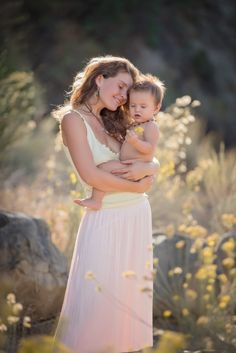 Happy mother and baby. By Heather Neilson Photography.