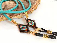 Unique gift ideas for mom, nana, BFF, mother in law or coworkers. A turquoise leather eyeglasses chain incorporating a hand woven beaded medallion. Bead Art, Eyeglasses, Turquoise Bracelet, Gifts For Her, Sunglasses Holder, Unique Gifts, Law, Chain, Gold