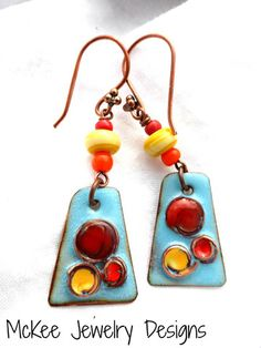 Yellow, red orange glass and copper metal enamel charm earrings.