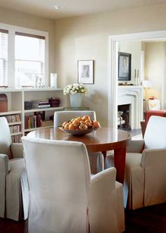 Walls painted taupe visually  connect the dining are to the adjoining living room.