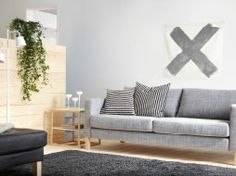 KARLSTAD three-seat sofa with Isunda grey cover and IKEA PS 2012 side table in white/bamboo