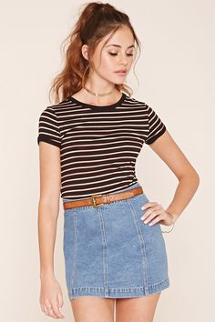 A stretch knit tee featuring an allover striped pattern, contrast trim, short…