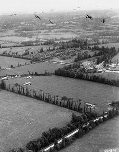 Normandy: A U.S. Army Air Forces Douglas C-47 Skytrain aircraft bank for England after their CG-4A gliders have cut loose from their tow lines. Note the Airspeed Horsa gliders on the ground.