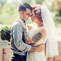 Krisll rocked colorful tattoos and a succulent bouquet on her big day. She also included a more traditional hair embellishment (created by Camilla Christine) and waist-length veil (designed by Over The Moon Bridal on Etsy), which created a dynamic sense of contrast.