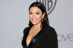 Baby's first red carpet! Pregnant Eva Longoria glows at Golden Globes as she tenderly cradles her bump