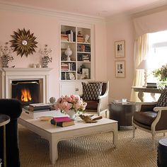 Pink adds a jolt of energy to a traditional space while complementing both classic shapes and dark woods.