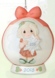 This year's Precious Moments 2015 Dated Ball Christmas Ornament is titled: You Make the Season One of a Kind. It features a girl holding a snowflake with the 2015 date on the front. Click image to order! #PreciousMoments #2015 #Christmas #Ornament