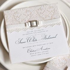 Complement that dreamy fairy tale with the stunning Elegant White Lace Invitation. The use of pearl paper and flocked paper turns a DIY bride into a classic princess. #DIYweddingideas