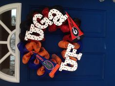 Georgia Bulldogs/Florida Gators mesh wreath house divided $45 (can ship my wreaths too)  https://www.facebook.com/pages/Wreaths-by-Michelle/462373083836425?ref=hl