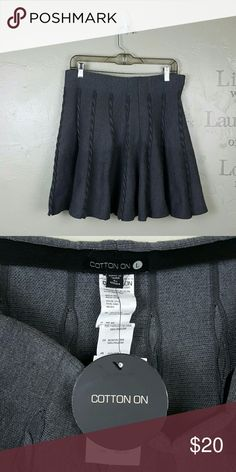 🏠MOVING SALE!Pretty Grey Skirt, NWT, by Cotton On A pretty grey flowy skirt by Cotton On. The fabric is thick and would look beautiful with leggings or tights and booties for the fall and winter. Size Large. Brand new with tags!  Laying flat: Waist 16 inches. Length 18 inches. Cotton On Skirts A-Line or Full