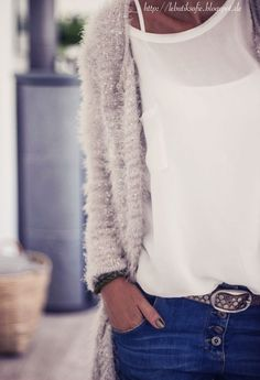This sweater is soft and pretty. It is paired perfectly with the soft blouse. Mixed textures that work.