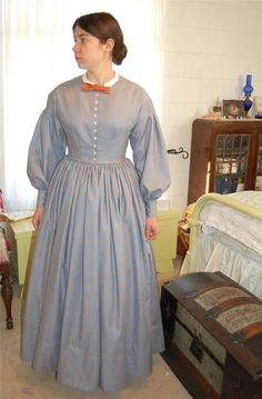 1860s dress with all the basic elements - dropped armholes, round waist, a fitted bodice with 2 darts on each side.