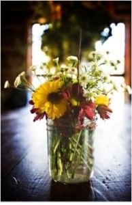 mason jar idea for centre peice with mixed country flowers and candles around it
