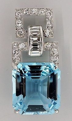 One of a kind Art Deco top quality handmade Platinum Asscher cut natural 17.23ct Aqua pendant with round and baguette diamond accents. Circa 1920-1930. Via 1stdibs.