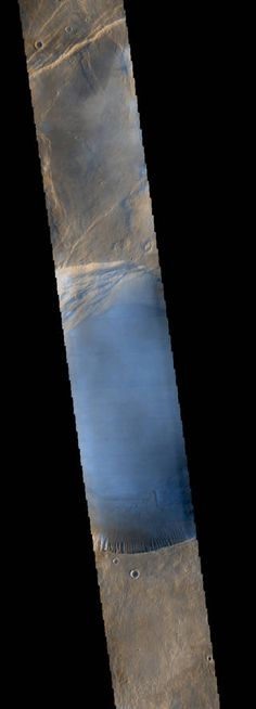 Seen shortly after local Martian sunrise, clouds gather in the summit pit, or caldera, of Pavonis Mons, a giant volcano on Mars, in this image from the Thermal Emission Imaging System (THEMIS) on NASA's Mars Odyssey orbiter. Credits: NASA/JPL-Caltech/Arizona State University