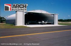 Prefab aircraft hangar for sale. Steel arch kits ready to be shipped and installed nationwide in just a few weeks. Arch Building, Building Design, Quonset Hut, Private Plane, Prefab Homes, Steel Frame, Garage Doors, Aircraft, Outdoor Decor