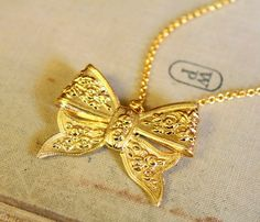Big gold bow  necklace  14 k gold plated  bow and by iloniti, $28.00