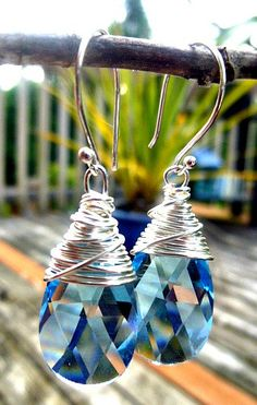 Aquamarine faceted pear drop pendants in Swarovski crystal with sterling silver wire wrapping.