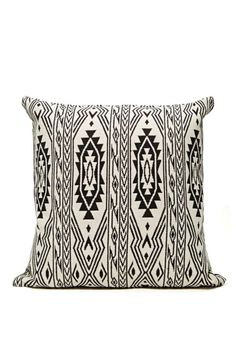 Cozy up in this rad white and black pillow featuring a Southwestern-inspired print, zip closure at side, and an 18x18 insert.