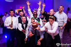 Football wedding ideas-- toss the garter on a football, it's a clever way to bring in your interests and personalize the boquet and garter wedding traditions :).  lvc-wedding-photographer-best-harrisburg-lebanon-york-hershey-wedding-photographers-creative-artistic-unique-personal-natural-38