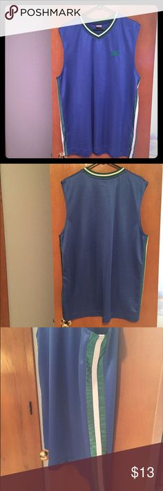 Nike sleeveless tank Blue V-neck tank with white and green stripes. Super comfy and lightweight. Mesh material may snag easy. Nike Shirts Tank Tops
