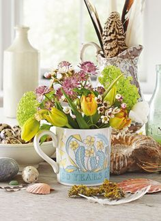 """country flowers in a mug designed by artist Angie Lewin for the 30ieth anniversary of """"Country Living."""""""