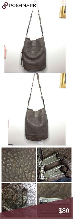 Rebecca Minkoff grey hobo handbag Overall good condition! Has a blemish on one side that is shown in the collage with 4 photos. Color is a tawny gray. Rebecca Minkoff Bags Hobos